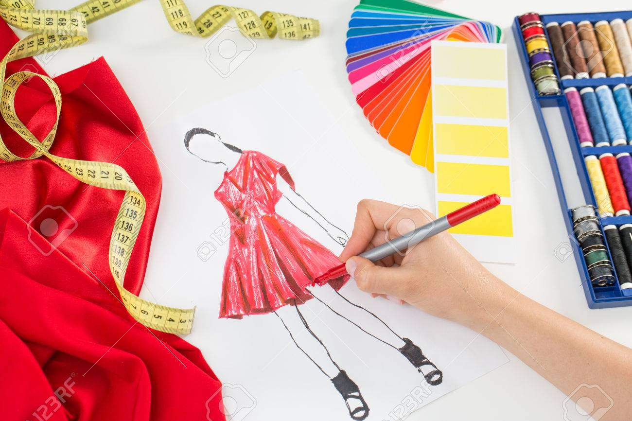 44883771 fashion designer working in studio close up design